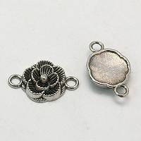 kovinski vmesnik 12x3,5 mm, roža, b. starega srebra, 1 kos