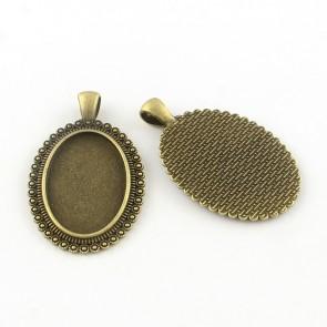 osnova za obesek - medaljon 48x30x2 mm, antik, brez niklja, velikost kapljice: 30x20 mm, 1 kos