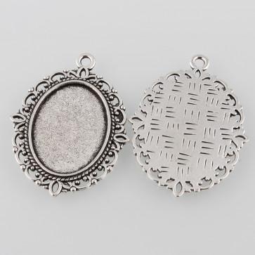 osnova za obesek - medaljon 40x30x2mm, b. starega srebra, velikost kapljice: 18x25 mm, 1 kos