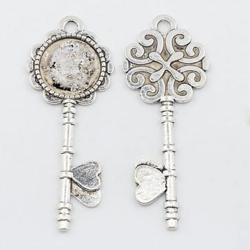 osnova za obesek - medaljon 72x28x2.5 mm, b. starega srebra, brez niklja, velikost kapljice: 20 mm, 1 kos