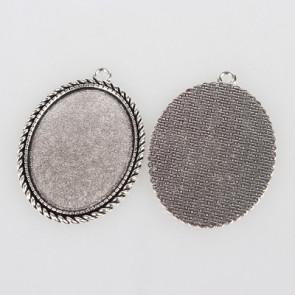 osnova za obesek - medaljon 51x37x2mm, b. starega srebra, velikost kapljice: 30x40 mm, 1 kos