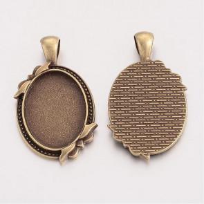 osnova za obesek - medaljon 42x24x3mm, antik, brez niklja, velikost kapljice: 25x18 mm, 1 kos